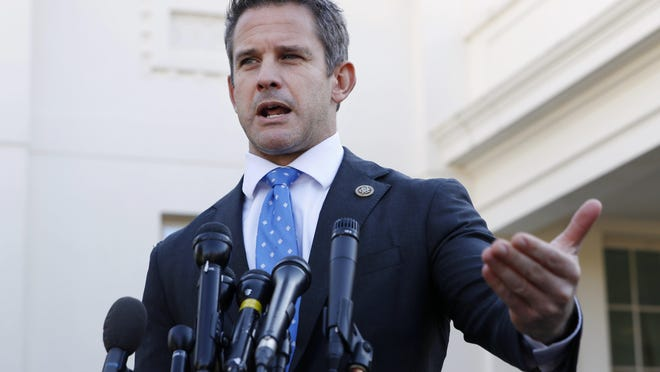 In this March 6, 2019, photo, Rep. Adam Kinzinger, R-Ill., speaks to the media at the White House in Washington.