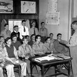 Aero Reserve Trainees Get First Instruction - Aero Reserve Training Corps, uniformed Rochester youths who are preparing for aviation careers, gets off to a fast start with Philip J. Schneider instructing, as classes open at Jefferson High School. Youths in above group are part of Flight A of the corps being formed under sponsorship of The Times-Union and The Democrat and Chronicle. (Staff photo, 4/1983) TU 4/28/1943