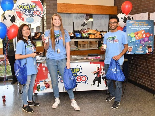 "Students at Piscataway High School enjoy breakfast from their new ""Grab n Go"" breakfast cart, which was unveiled at a celebration hosted by American Dairy Association North East on March 6 during National School Breakfast Week."