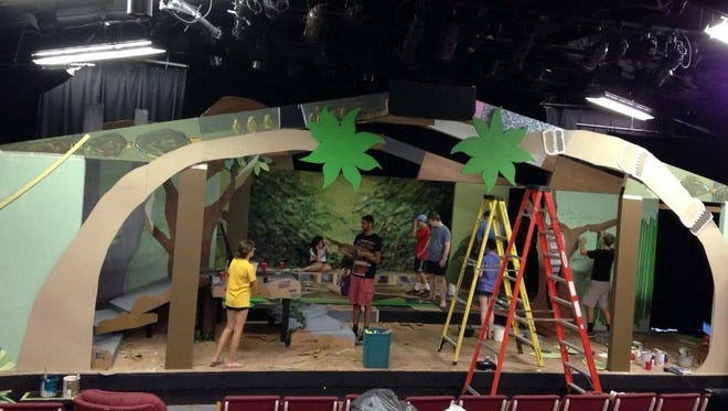 "Participants in the Possum Juniors program build the set for their production of ""The Jungle Book."""