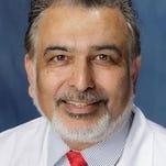 Dr. Rajiv Tandan