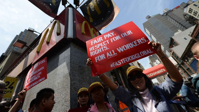 Fast-food workers protest in front of a McDonald's restaurant in New York on May 7, 2014.