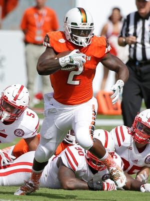 Miami running back Joseph Yearby (2) rushed for 125 yards and a touchdown vs. Nebraska on Saturday.