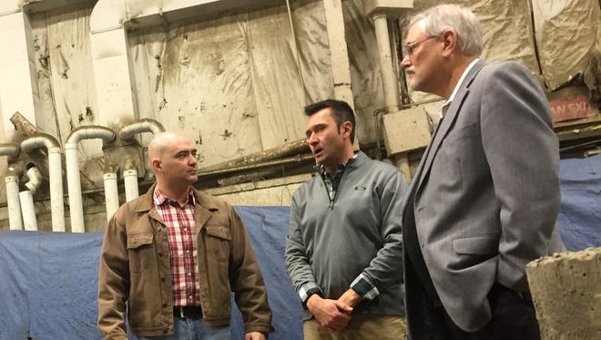 New York state Sen. Fred Akshar, left, speaks with Binghamton Precast Vice President Kevin Palachick, center, and Ronald Thornton, executive director of the Precast Concrete Association and a former Binghamton Precast employee.