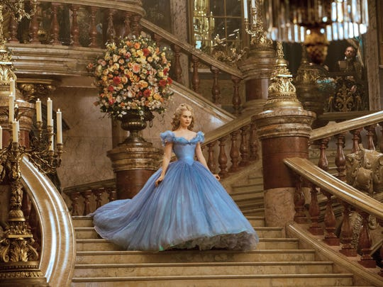 """Lily James as Cinderella in Disney's live-action feature inspired by the classic fairy tale, """"Cinderella."""""""