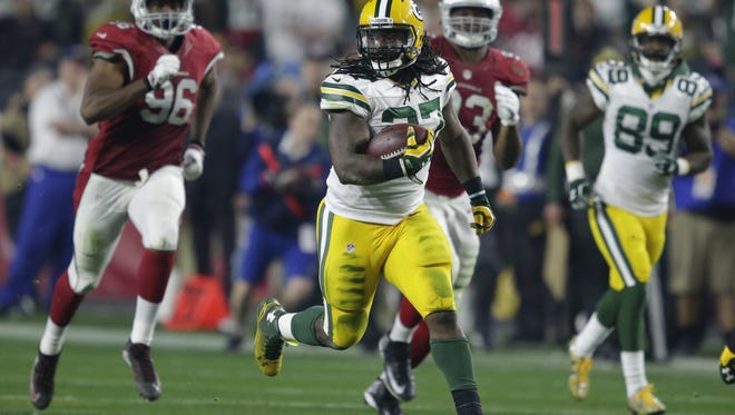Green Bay Packers' Eddie Lacy breaks free for a long run to the 8-yard line.  The Arizona Cardinals host the Green Bay Packers during a NFC divisional round playoff football game Saturday, January 16, 2016, at the University of Phoenix Stadium  in Glendale, AZ.