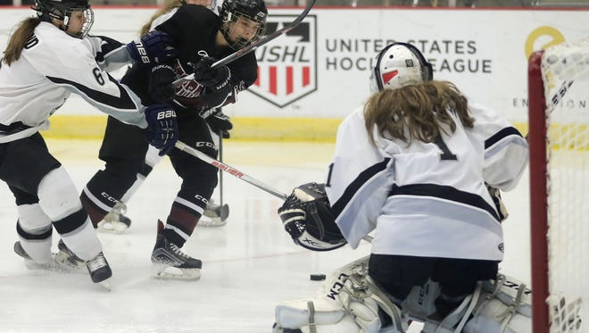 Eden Gruber, right, had four goals over a span of two games for the Central Wisconsin Storm girls hockey team this past weekend.