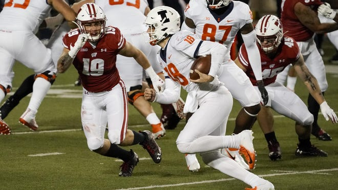 Illinois quarterback Brandon Peters runs during the second half of last Friday's game against Wisconsin, in Madison, Wis. Wisconsin won 45-7.