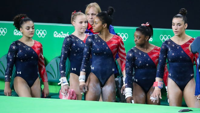 The United States team looks on the floor during women's gymnastics qualifications in the Rio 2016 Summer Olympic Games at Rio Olympic Arena.