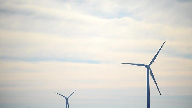 Wind turbines near Lake Benton, Minn., on Wednesday, Dec. 11, 2013. (Joe Ahlquist / Argus Leader)