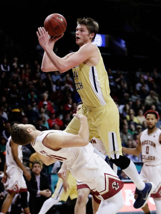 Georgia Tech's Ben Lammers (44) shoots over Boston College's Ervins Meznieks (10) during the first half of an NCAA college basketball game in the first round of the Atlantic Coast Conference tournament Tuesday, March 6, 2018, in New York. (AP Photo/Frank Franklin II)