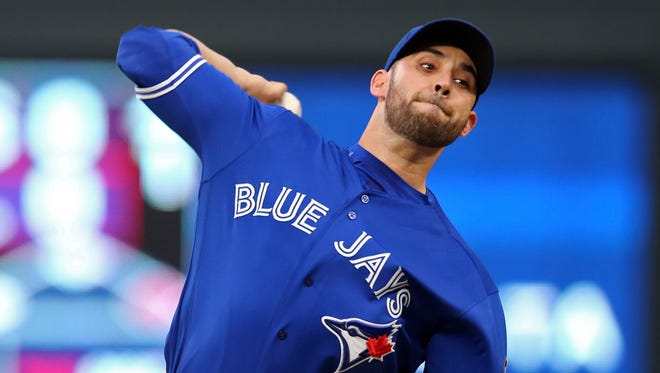 Toronto Blue Jays pitcher Marco Estrada throws to a Minnesota Twins batter during the first inning of a baseball game Tuesday, May 1, 2018, in Minneapolis.