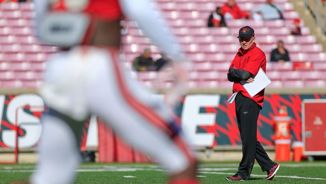 """Louisville head coach Bobby Petrino during Spring scrimmage Saturday. """"Last part of the scrimmage was really about toughness,"""" Petrino said. """"We try to run the ball every snap and let our players understand that, at some point in the fourth quarter, you're going to have to run the ball to win, or stop it to win.""""  By Matt Stone, The C-J April 11, 2015."""