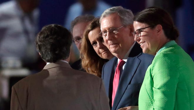 Senate Majority Leader Mitch McConnell, R-Ky., checks out the stage before the second-day session of the Republican National Convention in Cleveland, Tuesday, July 19, 2016.