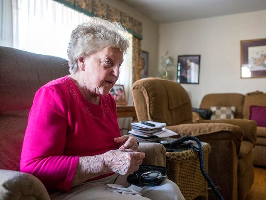 Betty Lanning, 76, checks her blood sugar in her South Asheville home Thursday. Lanning has been on Medicaid for about three years to help pay for her prescriptions and medical supplies for diabetes, neuropathy, fibromyalgia, high blood pressure and more.