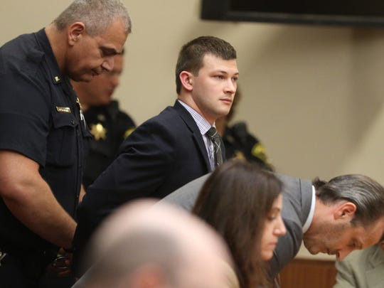 Colin Rideout is handcuffed after being found guilty.