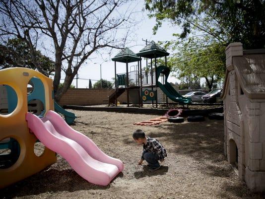 636435115581632401-kid-on-playground.JPG