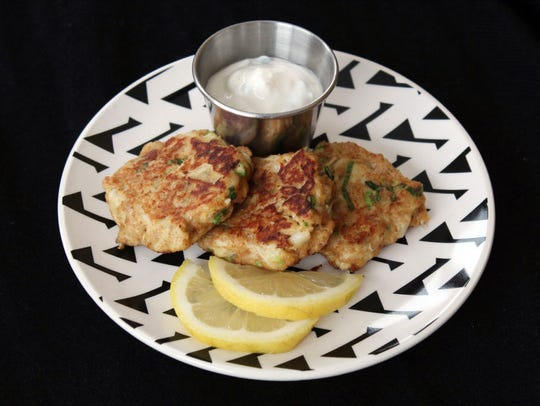 Mini Crab Cakes with Garlic-Chive Sauce are an entrée