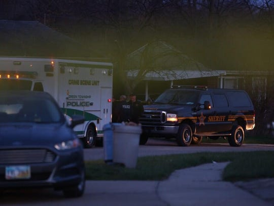 Authorities investigate the early morning shooting.