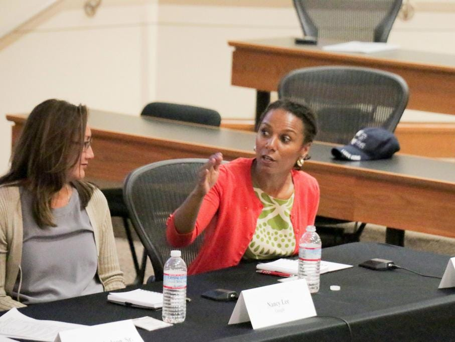 Maxine Williams, Facebook's global head of diversity, gestures on a panel on tech diversity. To her left is Nancy Lee, director of people operations at Google.