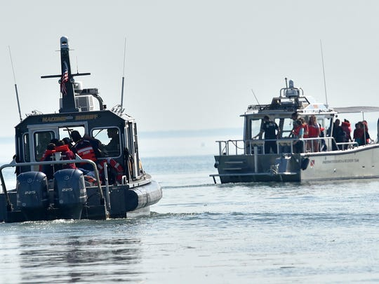 Students ride two of four boats during their patrol