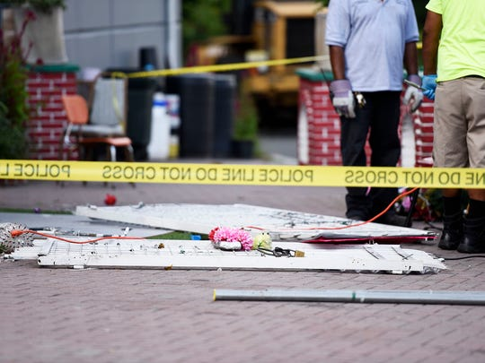 As workers in Passaic dismantle the Our Lady of Guadalupe shrine on Aug. 16, pieces of it sit on the sidewalk.