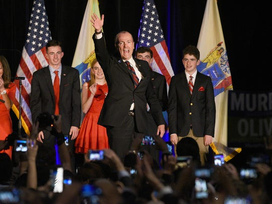 NJ gubernatorial candidate Phil Murphy with family, wife Tammy, Josh 20 and Emma 18, Charlie 16, and Sam 14, celebrates his victory with supporters after the polls close on election night after defeating his opponent, Lt. Governor Kim Guadagno. Murphy celebrates at the Convention Center in Asbury Park, NJ on Tuesday, November 7, 2017.