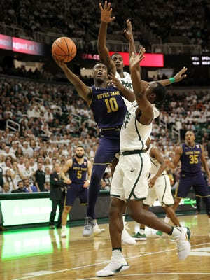Notre Dame Fighting Irish guard TJ Gibbs (10) drives to the basket over Michigan State Spartans guard Joshua Langford (1) during the first half of a game at the Jack Breslin Student Events Center.