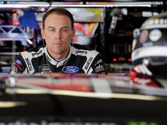 Kevin Harvick leans on his car in the garage during  NASCAR auto racing practice at Daytona International Speedway, Saturday, Feb. 18, 2017, in Daytona Beach, Fla. (AP Photo/Terry Renna)
