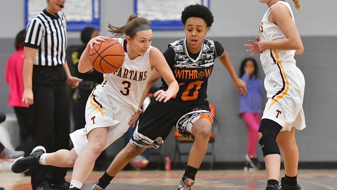 Turpin's Kaitlyn Workman drives past Withrow's Jerria White.