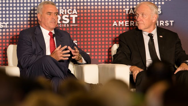U.S. Rep. Brad Wenstrup, R-Columbia Tusculum, left, and U.S. Rep. Steve Chabot, R-Westwood, talk about taxes during the America First Tax Cuts to Put America First event at  The Westin in downtown Cincinnati, Ohio, on Tuesday, Aug. 14, 2018.