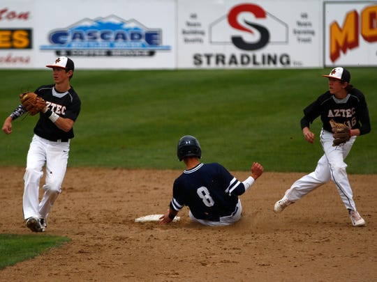 Aztec's Jake Taylor, left, and Zach Taylor try to turn a play against Piedra Vista's baserunner Andrew Caliendo on April 18, 2015, at Ricketts Park in Farmington.