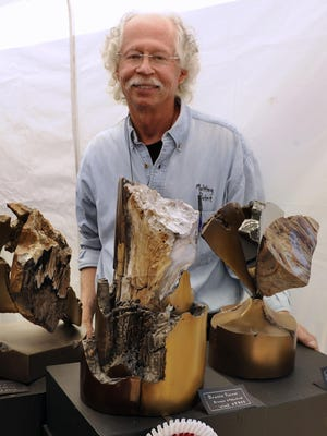 Local artist Sid Kamerman took Best of Show at the 2011 Great Gulfcoast Arts Festival for his work incorporating bronze, stainless, marble and wood.