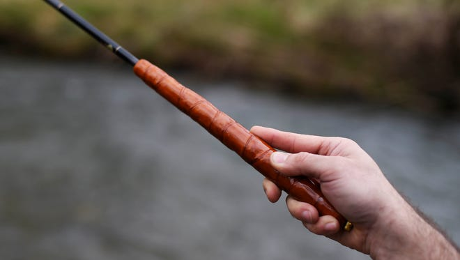 Jason Konopinski of Hanover uses his index finger to guide his tenkara rod to precise locations while fly fishing for trout on the west branch of the Codorus Creek in North Codorus Township Saturday, March 12, 2016. Tenkara rods have no reel, and are good for fishing small, fast moving streams and creeks.