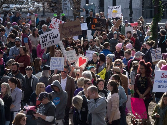 Attendees gather for the Knoxville Women's March at Krutch park in downtown Knoxville Sunday, Jan. 21, 2018. The crowd grew to 10,000 and spanned 10 blocks.