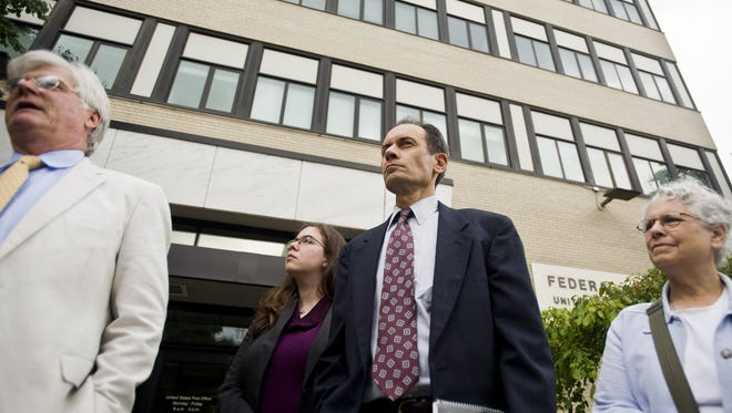 Dean Corren, center, the Progressive/Democratic candidate for lieutenant governor in 2014, and his lawyer, John Franco, left, challenge the constitutionality of Vermont's campaign financing law in U.S. District Court in August. A federal judge has ruled that part of Corren's case can proceed in federal court, though he must fight a looming $72,000 campaign-finance penalty in state court.