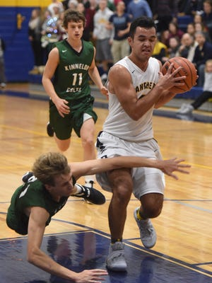 Pequannock's Grant Borovskis drives the lane against Kinnelon in a regular-season game last month in Pompton Plains. The two teams meet again on Wednesday night in a key NJAC-Independence matchup in Kinnelon.
