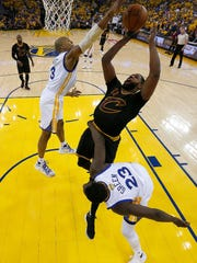 Warriors' David West (left) trying to block Cavaliers' Tristan Thompson during  Game 5 of the NBA Finals on Monday,