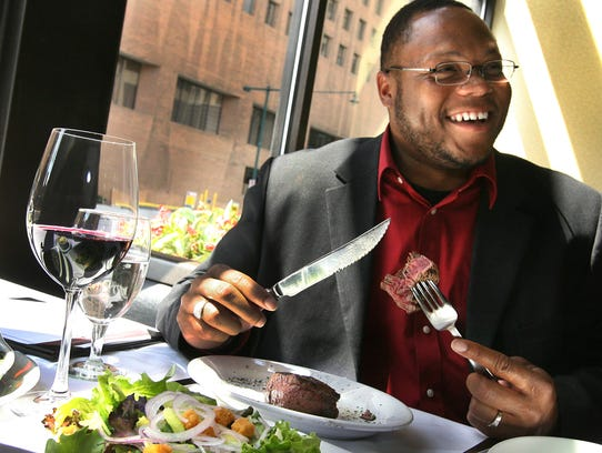 Roderick Wheeler digs into a filet at Ruth's Chris