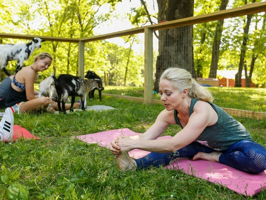 Stephanie Wubbena leads the class during Goats and Yoga on Herding Dogs Farm in Rogersville, Missouir, on May 19, 2018.