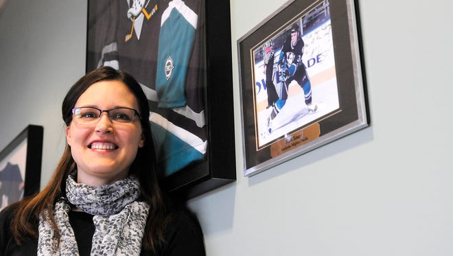 Dr. Kelly Sauer Collins specializes in treating head injuries. Her three brothers all retired from major league sports after suffering concussions. Memorabilia from the careers of all three is on display at Orthopedic Sports Center in Sartell, Minn.