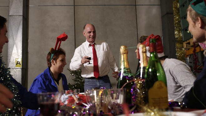 Group of workers celebrating at a holiday party.