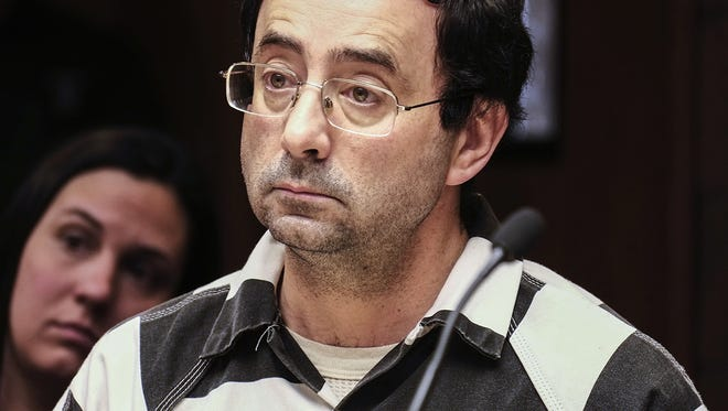 Dr. Larry Nassar listens to testimony of a witness during a preliminary hearing, in Lansing, Mich., Friday, Feb. 17, 2017. Three former elite U.S. gymnasts have come forward saying they were sexually abused by Nassar, a former doctor facing trial on another matter.