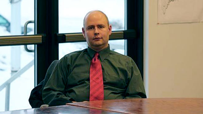Town Manager Tom Kawczynski sits in the Jackman, Maine, town hall on Jan. 23 before a select board meeting over his publicly espoused white separatist views.