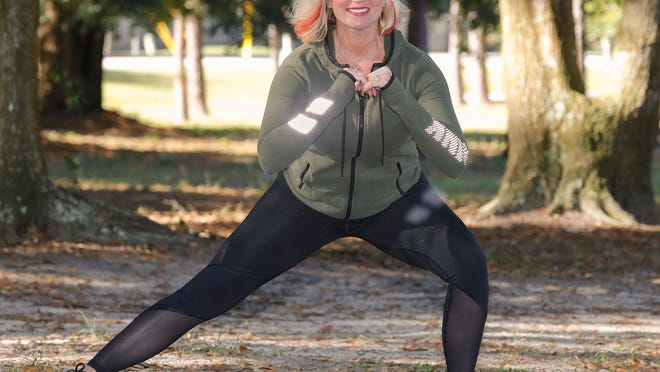Marlo Alleva demonstrates a side to side inner thigh stretch.