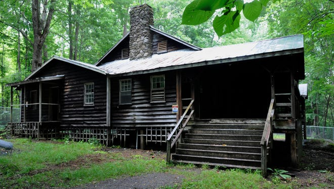 Great Smoky Mountains National Park's Appalachian Clubhouse (seen here in 2009 before restoration) and the associated cabins at Elkmont. The clubhouse is being restored by the park for day use.