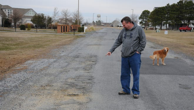 Matt Tomlins of Hammock Pointe in Crisfield shows the condition of the road into the subdivision.