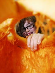Leila Duncan carves a pumpkin in 2013 for the annual Great Pumpkin Glow at Kingwood Center. A large crowd is expected at the event this year.