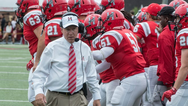 Huntingdon head football coach Mike Turk prepares for the start of the game as his team gets revved up. The Huntingdon Hawks took down N.C. Wesleyan 45-40 at home on Saturday, Oct. 3, 2015.