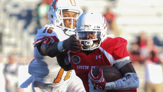 Austin Peay junior Kyran Moore (4) makes a reception as Mercer's LeMarkus Bailey (16) defends him during their game at Fortera Stadium on Saturday.